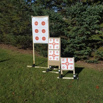 Paper target stands in tall, medium, and short configurations